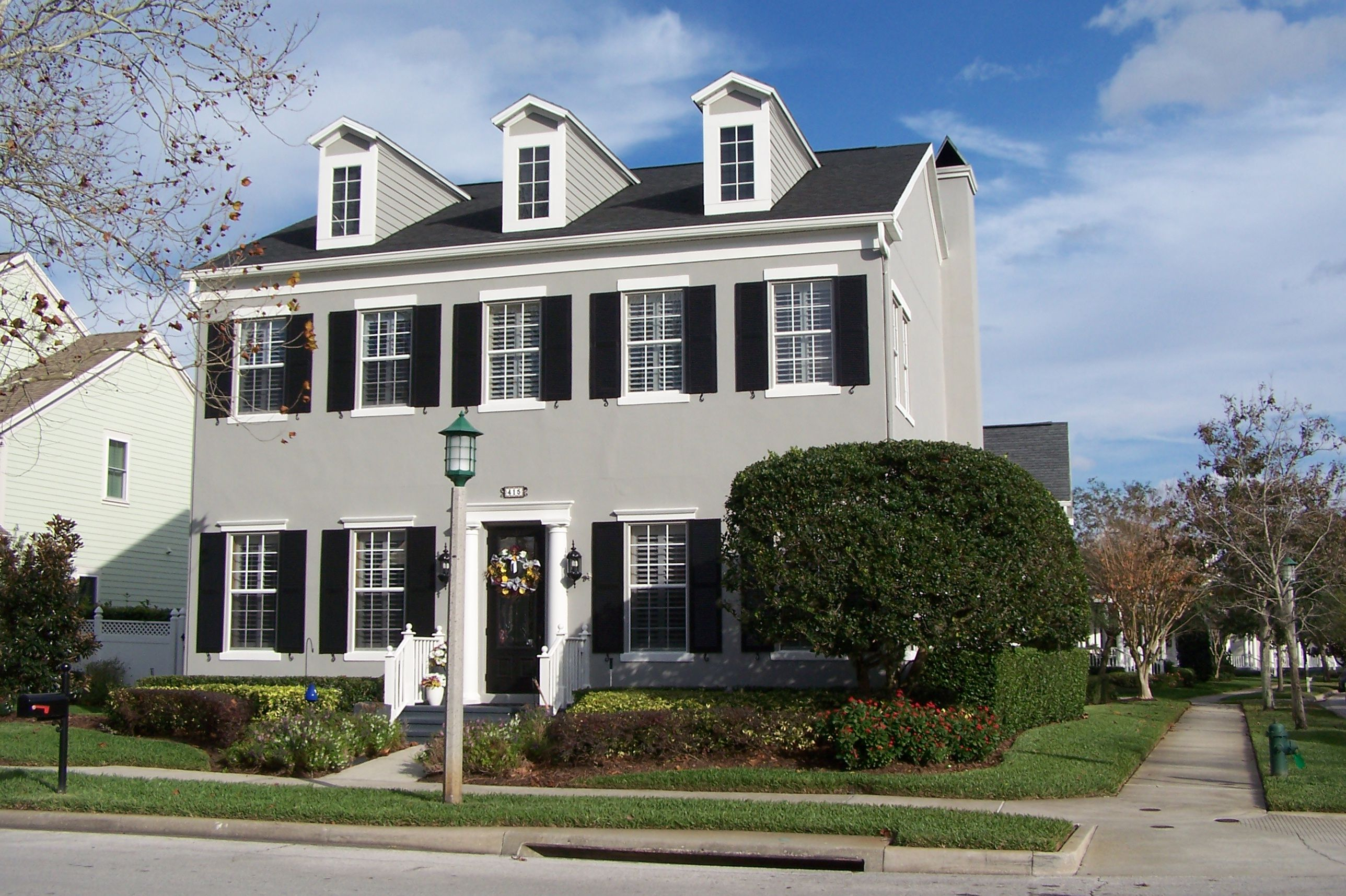 Two-story corner home with three dormers