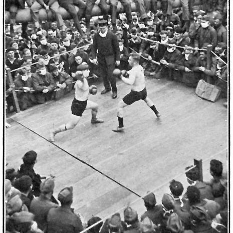 A picture of a boxing match on the ship's forecastle with the spectators wearing masks.