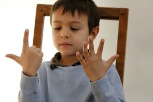 6-year-old boy counting with his fingers