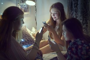 Teen girls using their smartphones