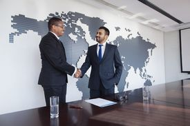 Two men shaking hands in agreement