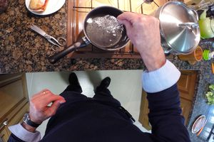 Adding salt to pot of water
