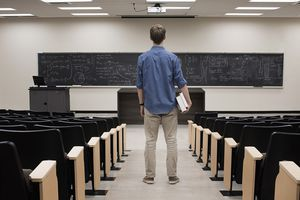 College student standing in classroom