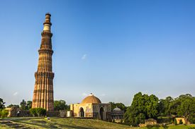 Qutub Minar against blue sky in Delhi