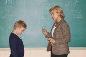 teacher scolding child