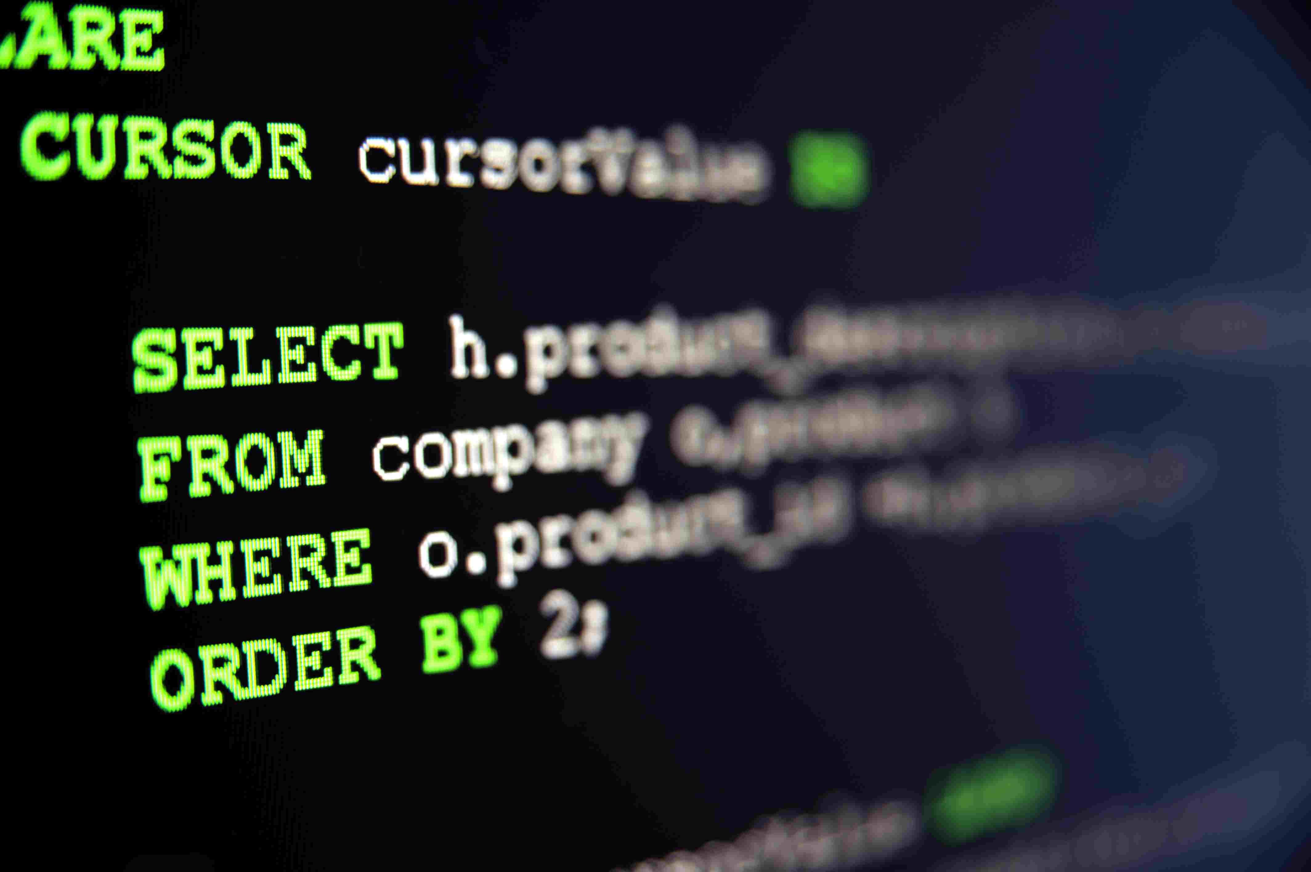 SQL code on black background