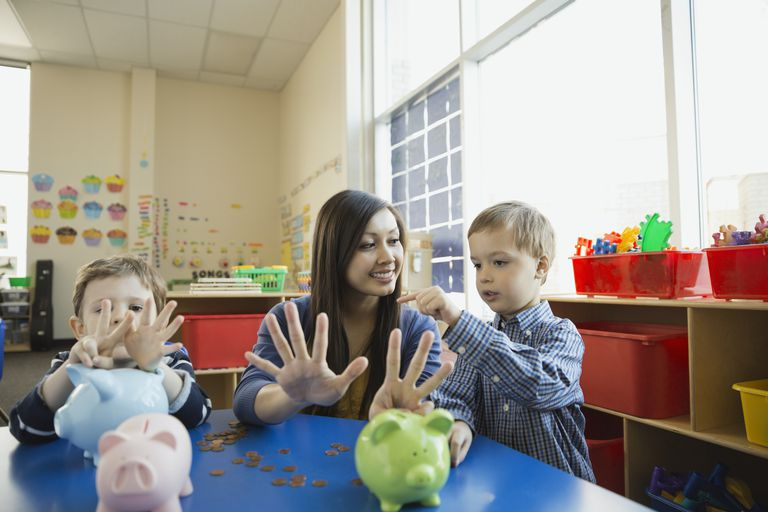 A teacher counting with students.