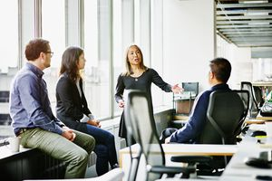 Mature businesswoman leading team meeting.