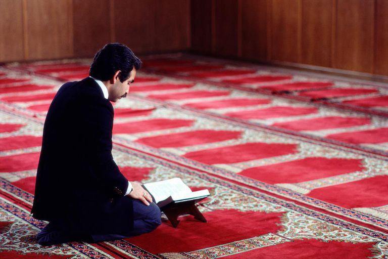 Muslim man praying in mosque, profile