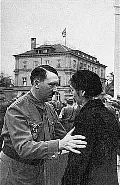 Adolf Hitler speaks to the widow of a Nazi party member