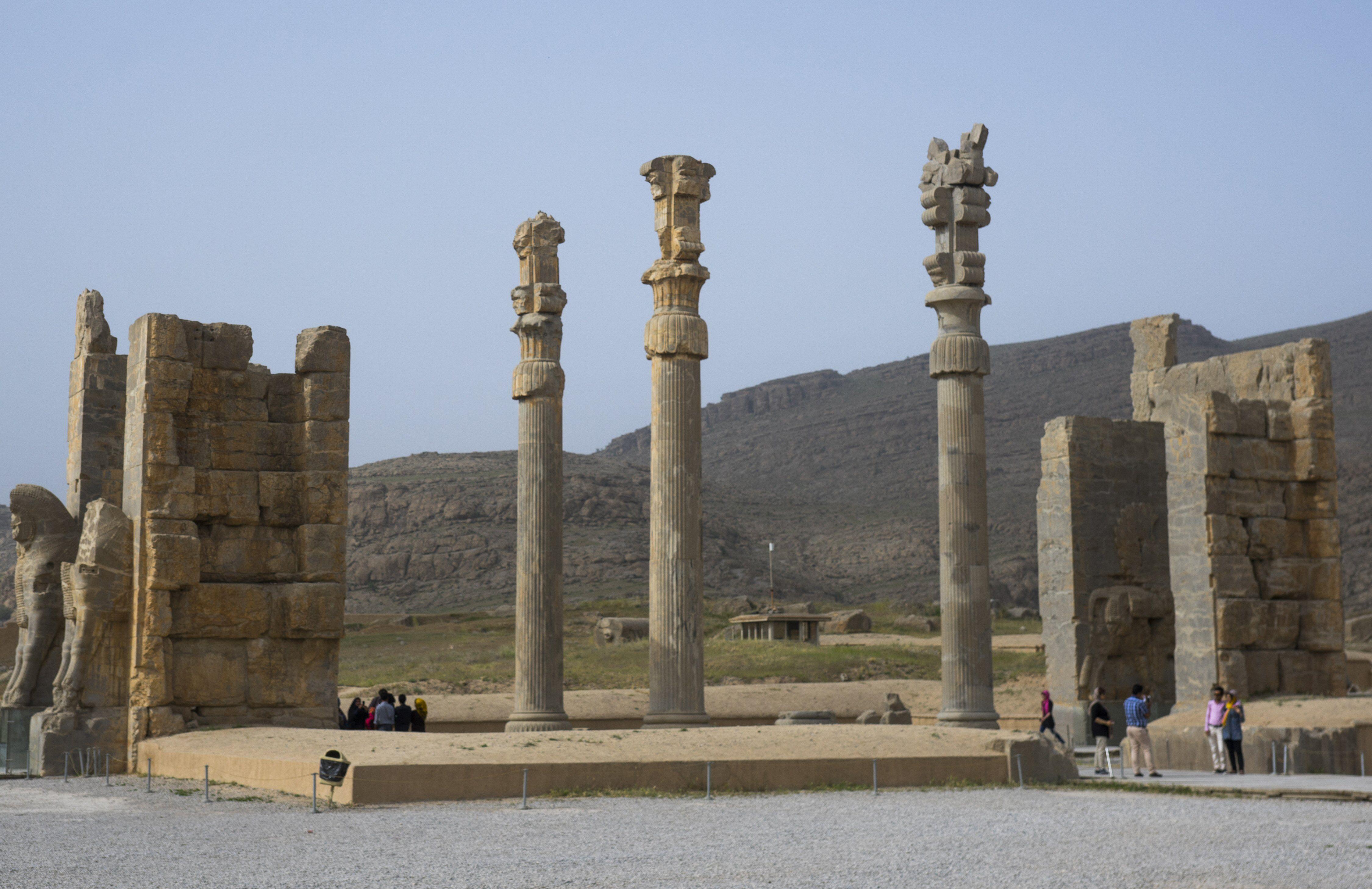ancient ruins, three tall columns with animal capitals