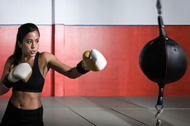 Female boxer with punch bag