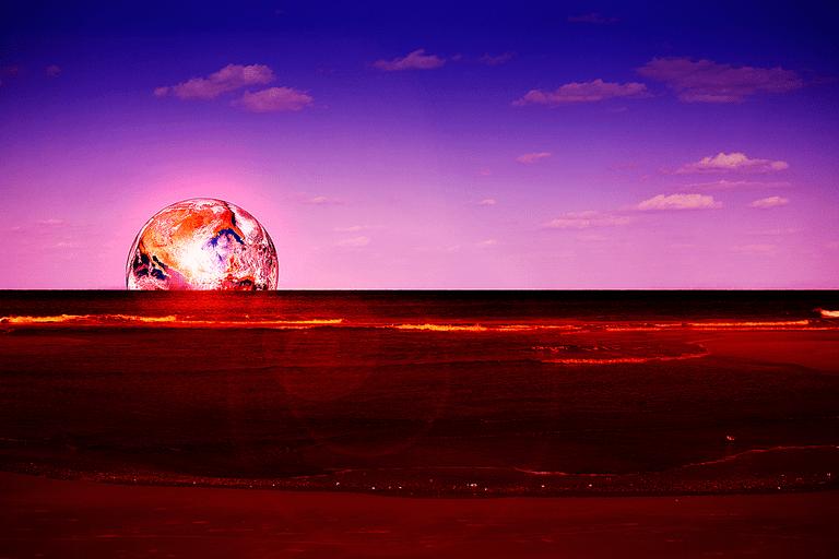 planet rising over horizon
