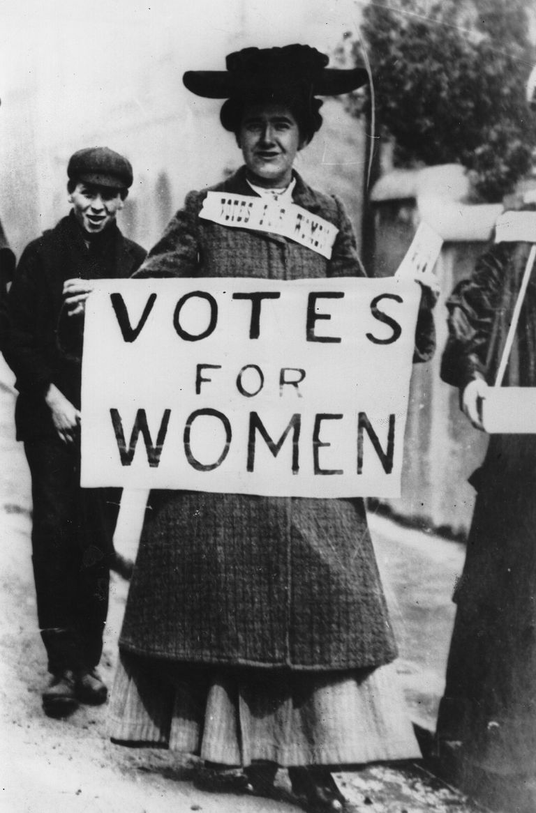 Tess Billington holding Votes for Women banner in London 1906