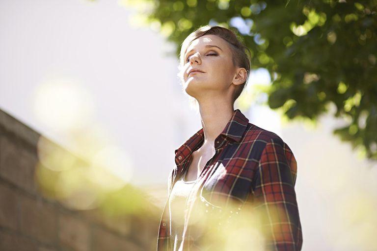 Girl with head tilted toward sky