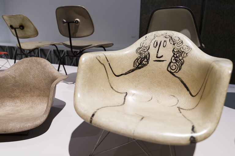 Molded plastic chair with naked woman drawn onto the surface from the exhibit The World Of Charles And Ray Eames in London 2015-2016