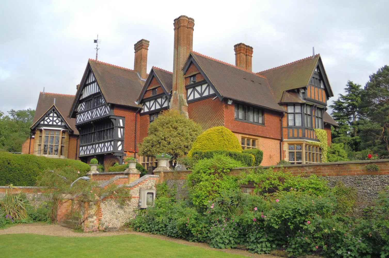 large home, multiple gables, multiple stories, multiple chimneys, Tudor detailing