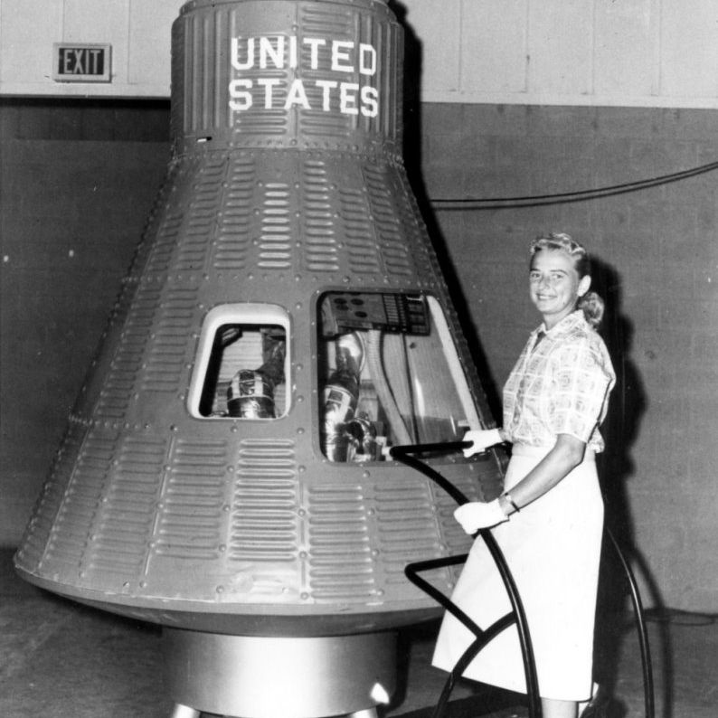Jerrie Cobb with a Mercury space capsule