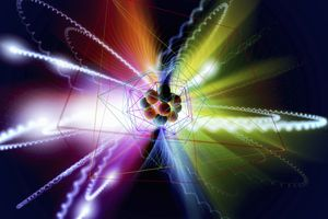 The nucleus of an atom with orbiting electrons rendered in vivid colors