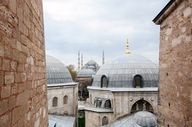 Domes of Hagia Sophia on foreground and Blue Mosque on foreground, Istanbul, Turkey