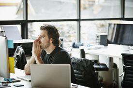 man thinking at desk