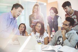 Professor talking to students in classroom
