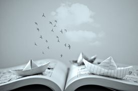 A book with paper boats