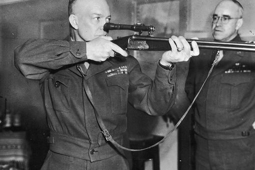 Commanding General of U.S. Army Europe, Dwight D. Eisenhower (1890 - 1969) firing a German-made combination rifle-shotgun with telescopic sight