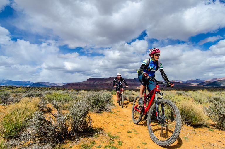 Two people mountain biking in the high desert