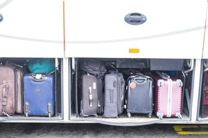 luggage stacked in a bus compartment