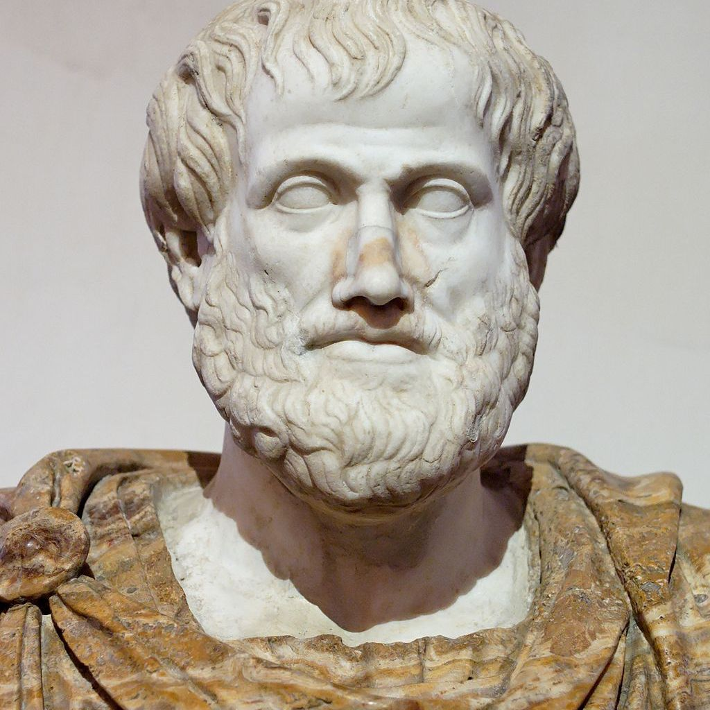 Statue of Aristotle on a gray background.