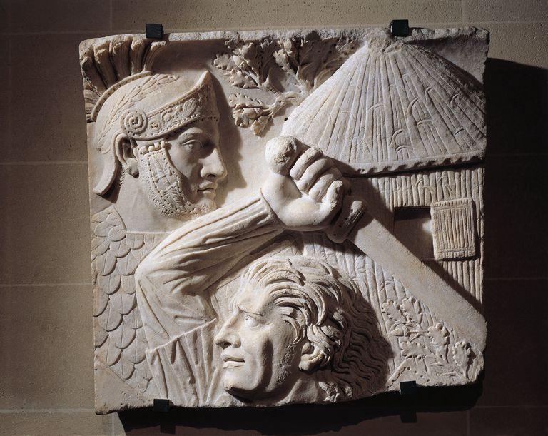 Marble relief representing a barbarian fighting against a Roman soldier (2nd century A.D.)