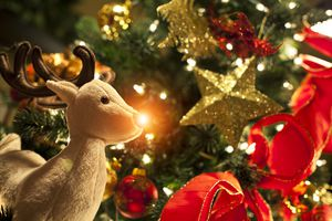 Rudolph toy with Christmas tree, lights, and ornaments