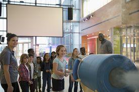 Children enjoying cloud cannon demonstration in science center