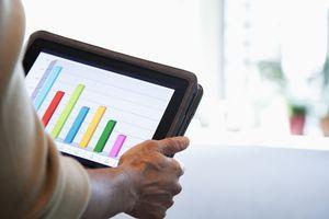 Person looking at bar graph on iPad.