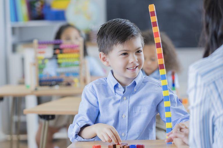 Confident schoolboy in math class