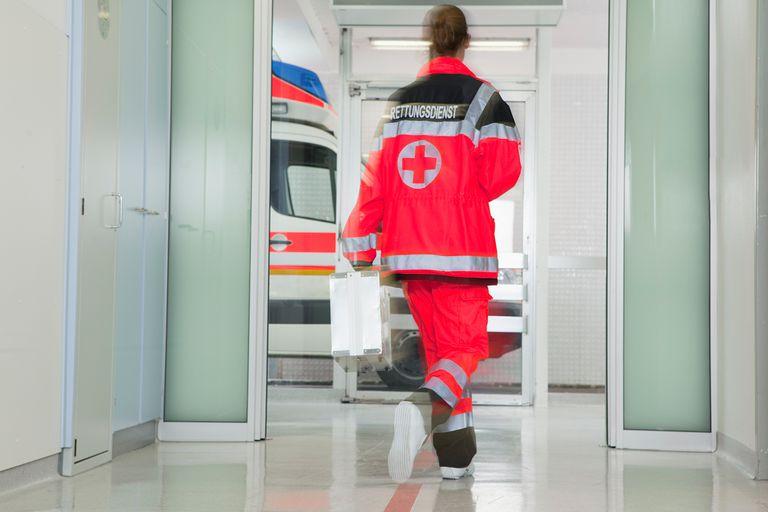 Back of paramedic rushing at hall.