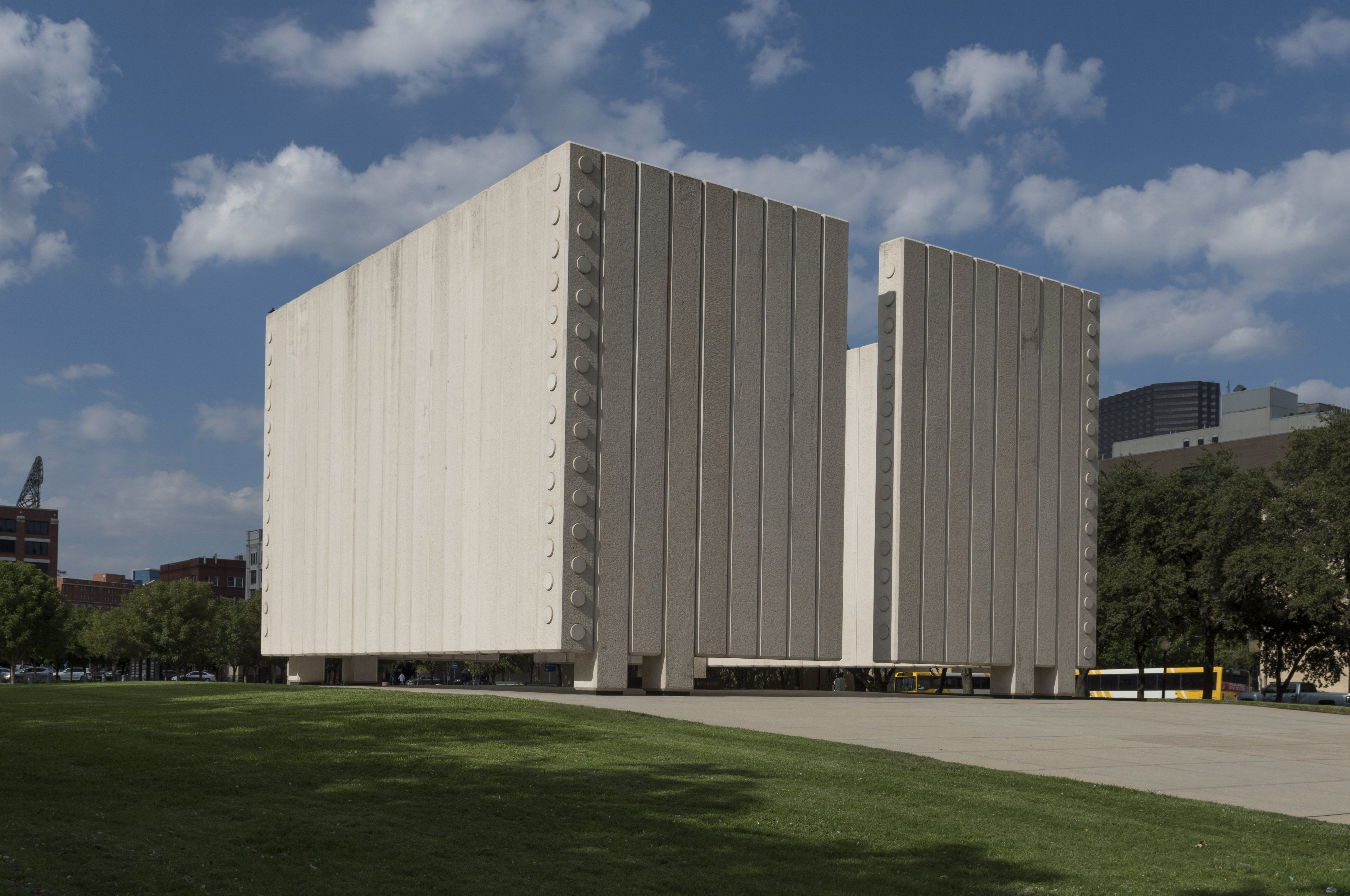 two large white concrete cubes that can be entered into