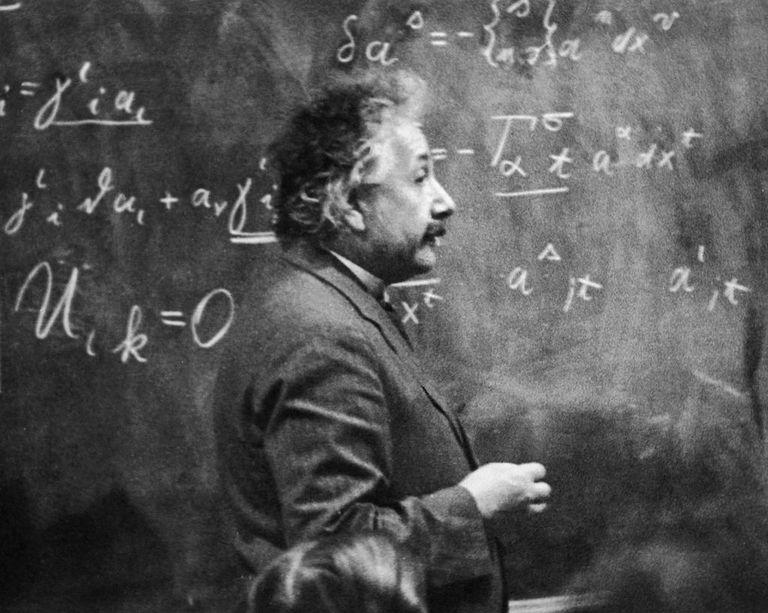 Einstein in front of a chalkboard
