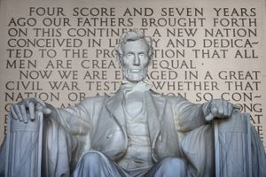 Statue of Abraham Lincoln with the Gettysburg Address behind the statue