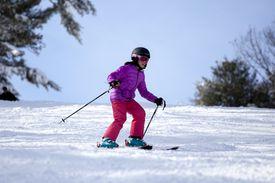 child skiing