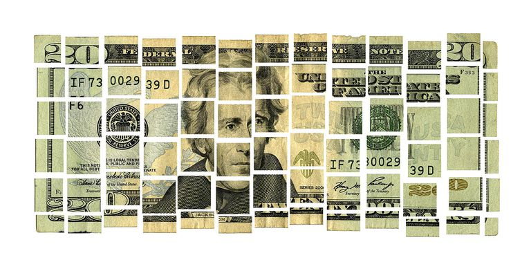 US twenty dollar bill in pieces