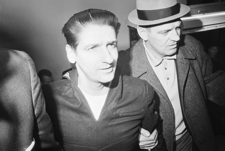 Black and white photo of Albert DeSalvo in police custody.