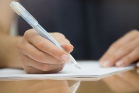 Photo of a woman writing, illustrating About.com's Essay Contests List.
