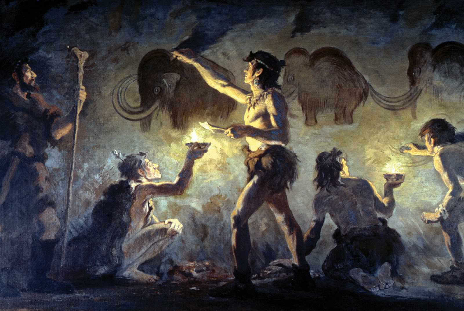 Early humans painting Woolly Mammoths