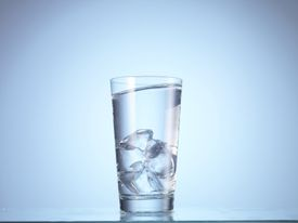 Heavy water ice cubes sink in water.