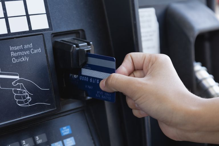 Using a credit or debit card at the gas pump.