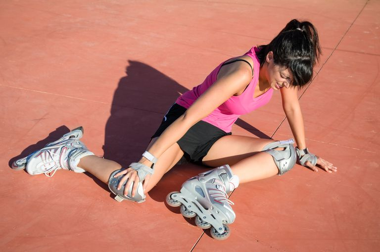 Woman roller blader on ground