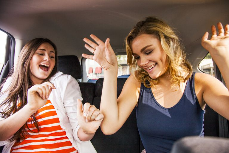 teens dancing in a car