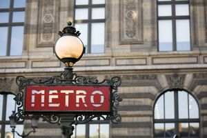 Red metro sign with light in Paris, France